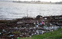 Dirt, trash and tree limbs littered White Rock Lake's shores and jogging paths after record-breaking rainfall hit parts of Dallas-Fort Worth in 2008.