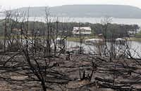 Drizzle on Thursday brought slight relief to the Possum Kingdom Lake area, where a wildfire has burned for a week.
