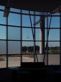 Wind turbines are visible through the windows of the library at the new Lady Bird Johnson Middle School.
