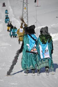 Participants take a ski lift during the 30th edition of the Belalp Witches Ski Race on January 14, 2012 in Belalp, Switzerland. The race is inspired by a legend dating back to the middle ages, of a witch who tormented villagers in the area until she was burnt to death.