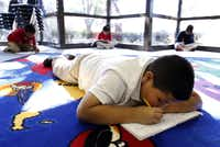 Fourth-grader Jonny Solis writes in his composition book during a writing time in a poetry class taught by Will Richey at Central Elementary School in Carrollton.