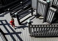 Jace Cantu, 3, runs through Pirate Cove at Wylie Founders Park. The structure is environmentally sound, and the volunteer effort that built it in 2004 provided a maintenance fund.