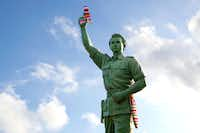 Austin-based textile artist Magda Sayeg of Knitta, Please, yarn bombed a statue in Bali. Her goal was the neuter the violence inherent in the weapons by knitting over them.