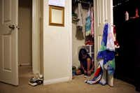 Aidelin Méndez ties her shoes inside her bedroom closet while getting ready for her first day of school. She has no idea that as a baby, she gave her mother, Yolanda Méndez, the  courage to escape from the closet where her abuser, Juan Garcia, held her captive and raped her in the presence of newborn Aidelin.