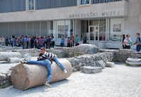 Kids play on an ancient column from the time of the Roman empire in Zadar's historic old city. The old Roman forum is part of a three-hectare site nominated for UNESCO World Heritage designation.